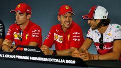 Antonio Giovinazzi (Alfa Romeo Racing) con Vettel e Leclerc (Ferrari)
