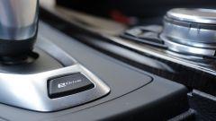 BMW Serie 3 330e: il tasto eDrive permette 3 modalità di guida
