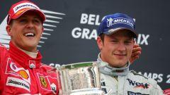 F1 2004: Kimi Raikkonen (McLaren) con Michael Schumacher (Ferrari) sul podio del GP Belgio