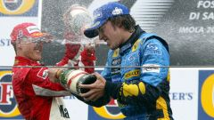 F1, Fernando Alonso (Renault) e Michael Schuamacher festeggiano dopo il GP San Marino 2005