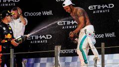 F1, GP Abu Dhabi 2019: Max Verstappen (Red Bull) e Lewis Hamilton (Mercedes) sul podio a fine gara