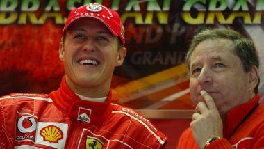 F1 GP Brasile 2004, Interlagos: Michael Schumacher sorride ai box con Jean Todt (Scuderia Ferrari)
