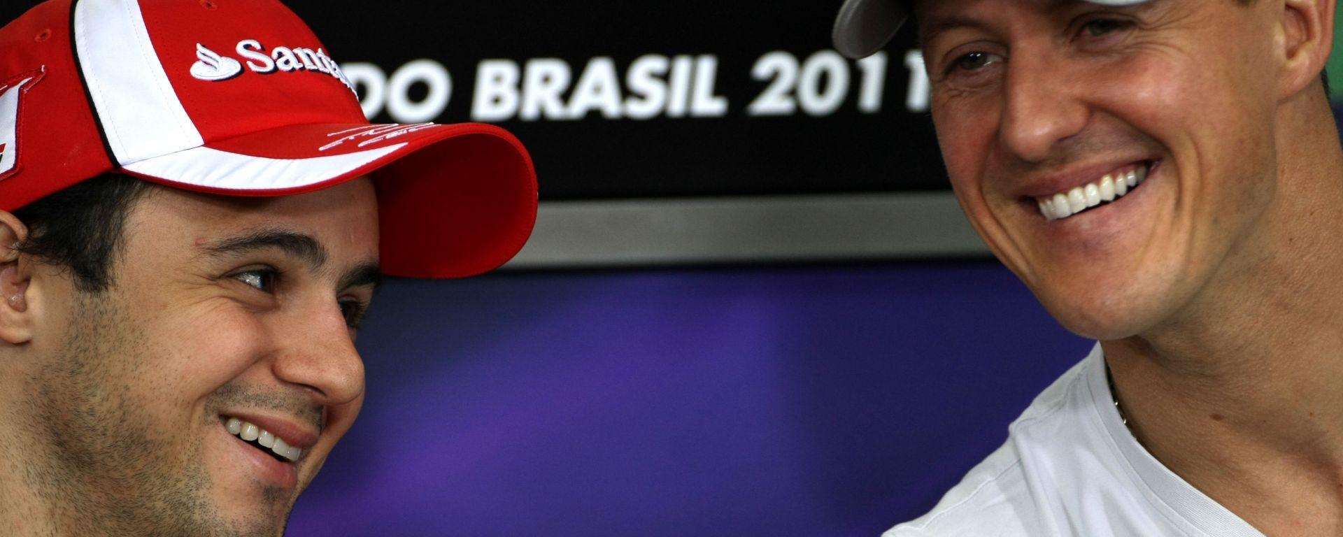 F1, GP Brasile 2011: Felipe Massa (Ferrari) e Michael Schumacher (Mercedes)