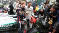 F1, GP Brasile 2012: Sebastian Vettel (Red Bull) con Michael Schumacher (Mercedes)