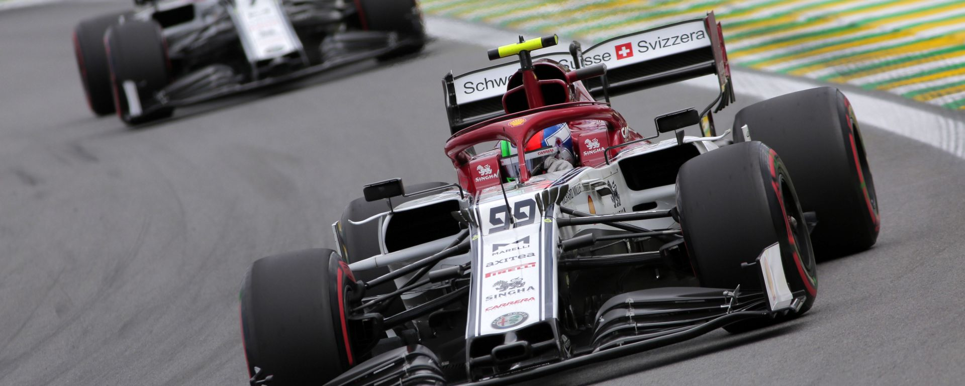 F1, GP Brasile 2019: Antonio Giovinazzi e Kimi Raikkonen (Alfa Romeo) impegnati sul circuito di Interlagos