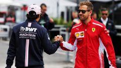 F1 GP Canada 2018, Montreal: Sergio Perez (Racing Point) e Sebastian Vettel (Ferrari) nel paddock