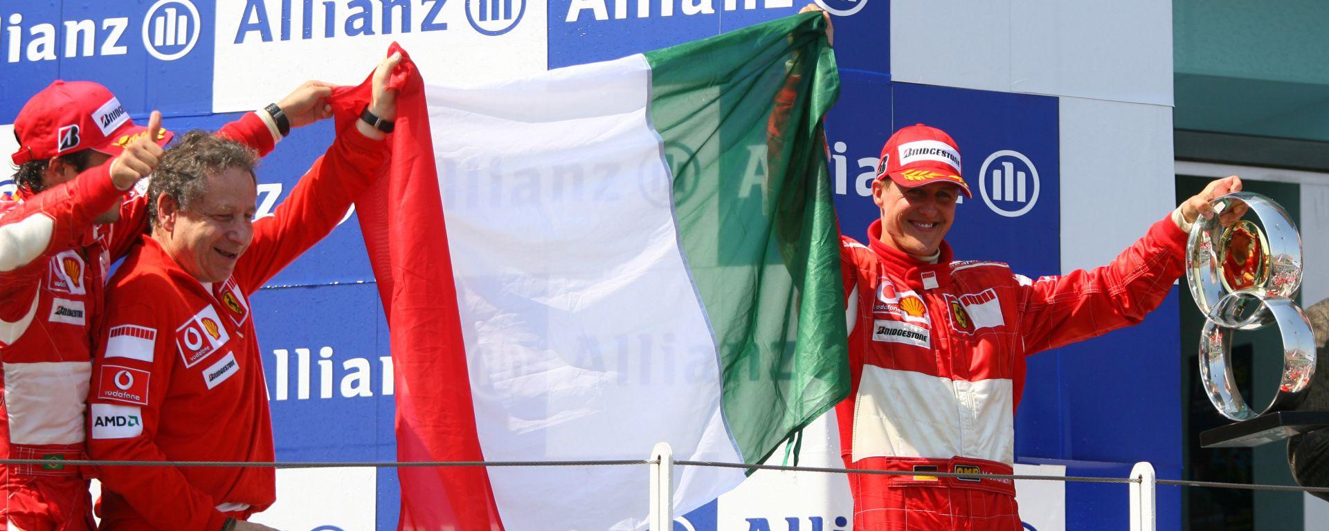 F1 Gp Francia 2006: Michael Schumacher (Ferrari) sul podio con Jean Todt e Felipe Massa