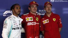 F1 GP Singapore 2019, Marina Bay: da sinistra Hamilton (Mercedes), Leclerc e Vettel (Ferrari)