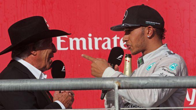 F1, GP Stati Uniti 2014: Mario Andretti sul podio con Lewis Hamilton (Mercedes)