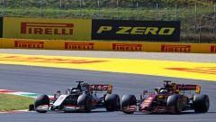 F1 GP Toscana 2020, Mugello:  Sebastian Vettel (Ferrari) in lotta con la Haas di Romain Grosjean