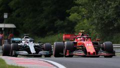 F1 GP Ungheria 2019, Hungaroring, Lewis Hamilton (Mercedes) e Charles Leclerc (Ferrari) durante le FP1