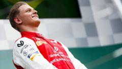 Formula 2, Budapest 2019: Mick Schumacher (Prema) sorride durante l'inno tedesco