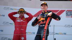 GP Austria 2019, Max Verstappen (Red Bull) festeggia sul podio davanti a un deluso Charles Leclerc (Ferrari)