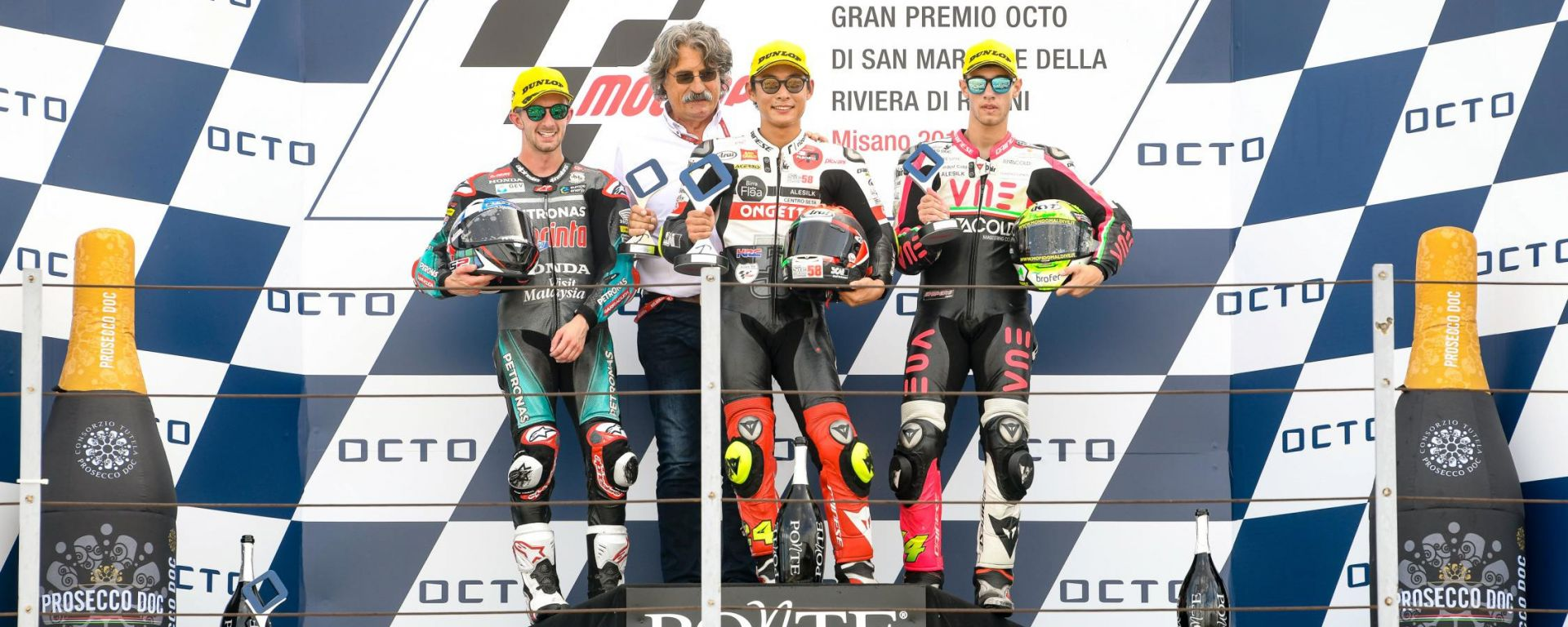 GP San Marino 2019, Misano, il podio della classe Moto2 con Suzuki e Paolo Simoncelli che festeggiano la vittoria, 2° McPhee, 3°