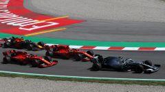 GP Spagna 2019, Sebastian Vettel e Charles Leclerc (Ferrari) dietro a Valtteri Bottas (Mercedes)