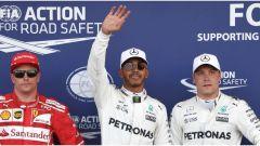 I primi tre classificati del Gran Premio d'Italia: Lewis Hamilton in mezzo a Kimi Raikkonen e Valtteri Bottas