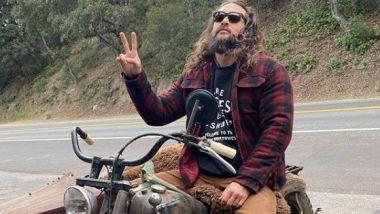 Jason Momoa in sella alla sua Harley-Davidson