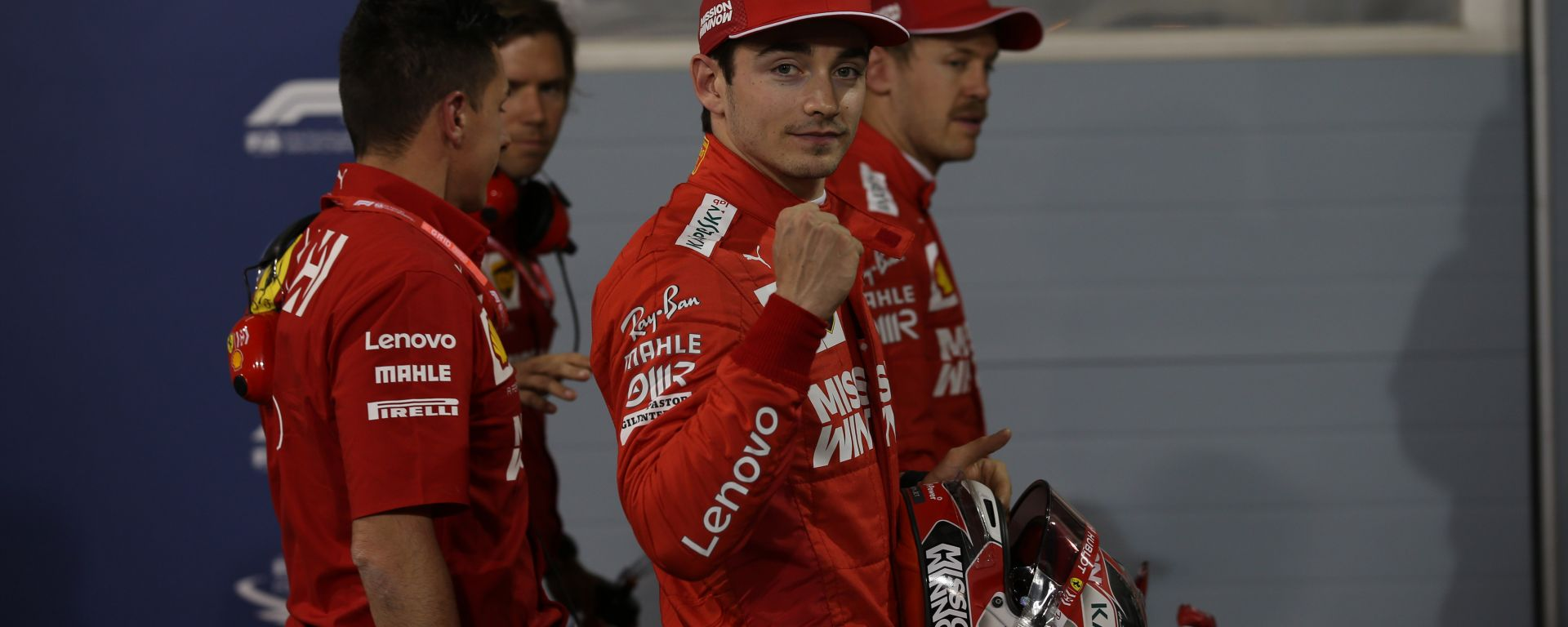 Leclerc esulta scortato da Vettel in pit-lane