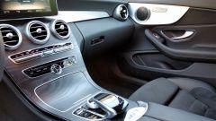 Mercedes C220d Cabrio 4matic: dettaglio dei comandi dell'infotainment