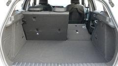 Nuova BMW 118i Sport DCT: il vano bagagli con profilo lineare e divanetto frazionabile