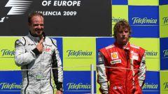 Rubens Barrichello (Brawn GP) e Kimi Raikkonen (Ferrari) sul podio del GP d'Europa 2009